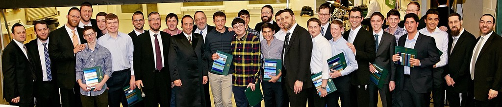 Prize winners and honored rabbi at DRS parent-son event.