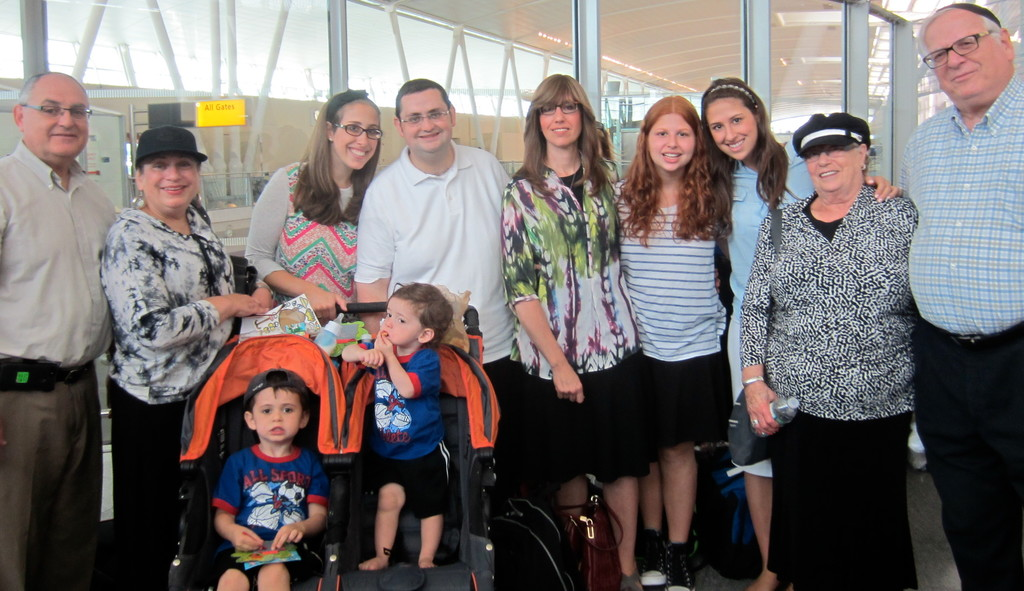 With their children Ezra and Avi in strollers, former HAFTR middle school rebbe Rabbi Yitzie Klapper and his wife Tova (pictured second and third from left) are about to make their aliyah. They were sent off on their journey home to Israel by (to their left) Josh and Barbara Klapper and (to their right) Marcia, Estie, Rivki, Shoshana and Sheldon Kreinberg.