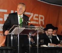 Senator Charles Schumer speaks at Achiezer's annual gala.