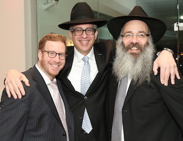 Guest of Honor Yoeli Steinberg with his associate at Gourmet Glatt, Moshe Ratner (left), and Rabbi Rabbi Zalman Wolowik of Chabad of the Five Towns.