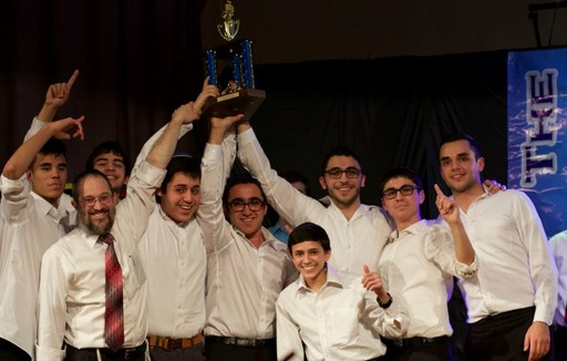 Rabbi Aharon Friedler and chorus members Max Baer, Eran Vaknin, David Aziz, Dylan Homapour, Jacob Mermelstein, Adam Livi, Matthew Maslin and Daniel Dilimani.