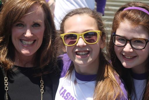 Shulamith students Malka Guttman and Hana Adler smile, at right with South Shore Rep. Kathleen Rice.