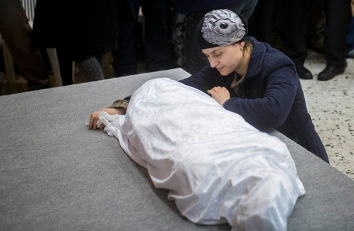 Adva Biton, mother of Adele Bilton, a 4-year-old Israeli Jewish victim of a Palestinian rock-throwing terror attack, cries over her daughter's body in February 2015.
