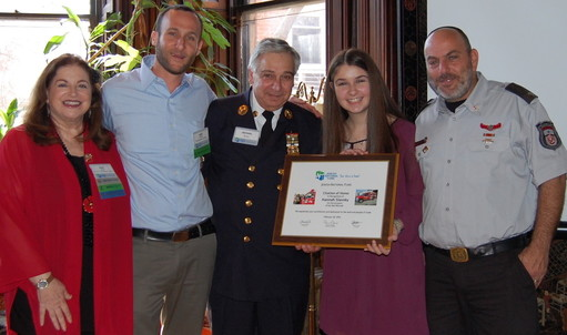 From left: Penny Rosen, host of Sunday's event and JNF board member; Ariel Kotler JNF's development officer of Israel operations; Michael Bono, a firefighter in Plainview / Old Bethpage, with his granddaughter, Hannah Slavsky of Old Bethpage, and Israeli firefighter Uri Chobotaro.