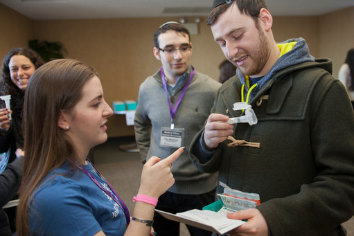 Hundreds register and give a sample of their saliva for genetic screening at Belfer Hall in the Sky Café on Feb. 13.