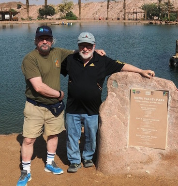 David and Robert Chudnow at the man-made lake created 30 years ago by their father, Avrum.