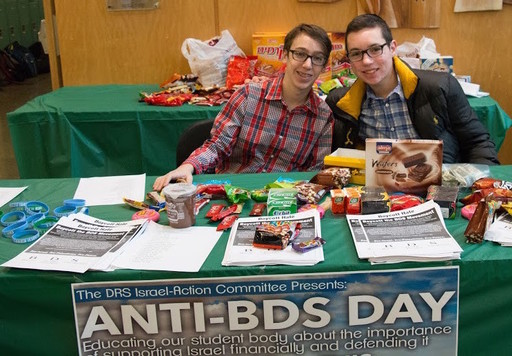 Freshman Harry Chwat and sophomore Sruli Fruchter sell Israeli-made goods at DRS's Anti-BDS Day sale, with the proceeds going to combat the BDS movement.