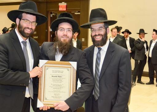 Rabbi Avrohom Bender, Menashe Malov and Rabbi Dovid Bender.