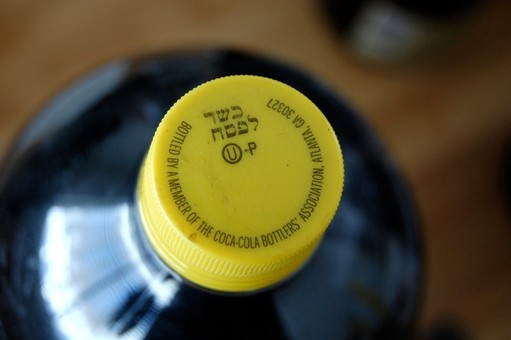 Kosher-for-Passover of Coca-Cola is distinguished from ordinary Coke bottles by its yellow cap.