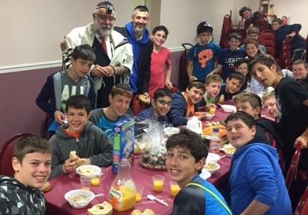 Young Israel of Long Beach Rabbi Chaim Wakslak and Rabbi Halbertal, with Rabbi Halbertal's students.