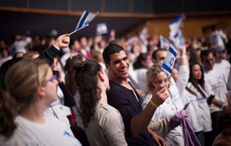 Young Jewish adults from all over the world participating in the Taglit Birthright program celebrate 10 years of the Birthright program at an event held at the International Conference Center in Jerusalem on Jan. 7, 2013.