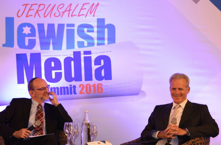 Michael Oren (at right) during a discussion at the Jewish Media Summit in Jerusalem.