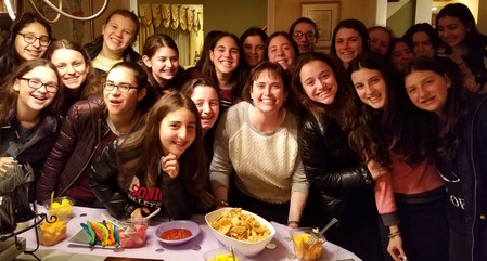 SKA Associate Principal Elana Flaumenhaft with ninth graders at a Thursday Night Tish in Woodmere.