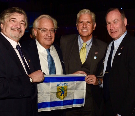 Holding a Jerusalem flag, David Friedman is pictured at the Dec. 4 gala of American Friends of Bet El with Great Neck activist Dr. Paul Brody (left), Town of Hempstead Councilman Bruce Blakeman and Great Neck activist Jeffrey Wiesenfeld.