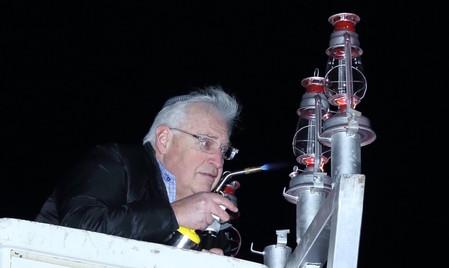 Ambassador designate David Friedman lights the Cedarhurst Park menorah on the second night of Chanukah.