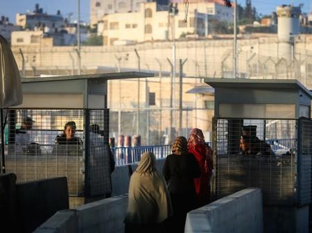 Palestinians cross the Qalandiya checkpoint, outside of Ramallah.