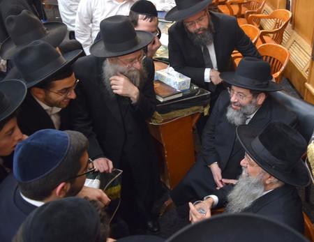 Pictured with Rav Hillel are Rav Shlomo Avigdor Altusky, center left; Rav Hillel's son; and Rav Yaakov Bender.