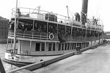Immigrants arriving at Ellis Island aboard the tender Machigonne in 1923.