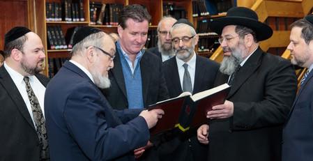 In a Yeshiva Darchei Torah beis medrash on Sunday (from left): Rabbi Baruch Rothman, Darchei's director of institutional advancement; Rabbi Shmuel Lefkowitz, Agudath Israel's vice president for Community Affairs; state Senator John Flanagan; Rabbi Chaim Dovid Zwiebel, Agudath's executive vice president; Rabbi Yaakov Bender, Darchei rosh ha yeshiva; and Chaskel Bennett, an Agudath trustee.