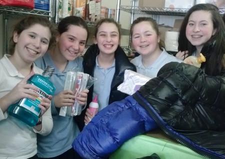 Food pantry volunteers: Lily Eisenberg, Chaya Sokel, Leora Friedman, Shashi Greenberg and Hodaya Landau.