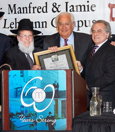 "Ambassador to Israel-designee David Friedman accepts YOSS' Ohev Yisrael Award in memory of his father, Rabbi Morris Friedman, a""h. He is flanked by Rabbi Mordechai Kamenetzky, YOSS rosh yeshiva."