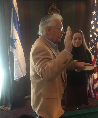 David Friedman appears to take the oath of office on Friday, one day after his appointment was approved by the Senate. This photo is from Twitter. No official photo was immediately released and Vice President Mike Pence said Sunday night that he would swear in Friedman later this week.