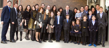 Rabbi Mordechai Besser with his children and grandchildren outside MDS on April 2, the day of the Upper West Side school's 74th Annual Scholarship Dinner.