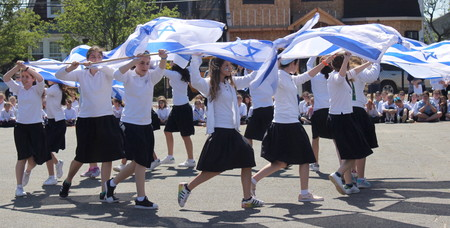 Happy day, Israel: Shulamith girls held the blue-and-white aloft outside their Cedarhurst school on May 2.