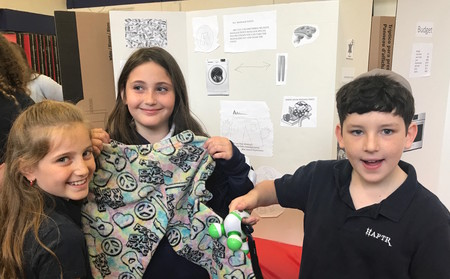 A pants prototype created by HAFTR fifth-graders (from left) Monica Fox, Sivan Laniado and Noah Popack.