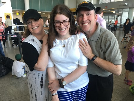 Gabriella Kate (center) couldn't contain her enthusiasm as she prepared to board Nefesh B'Nefesh's Israel-bound El Al charter. Sending their daughter off, Gabriella's parents were filled with joy.