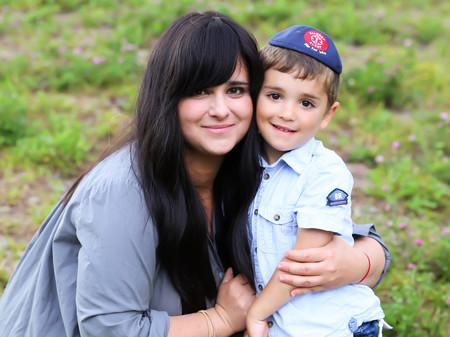 """Chanie Apfelbaum with her """"Allergy Alert"""" kippah-wearing son, Peretz."""