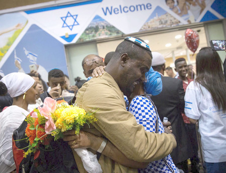 Ethiopian Falash Mura are greeted by family members as they arrive at Ben Gurion airport on June 06.