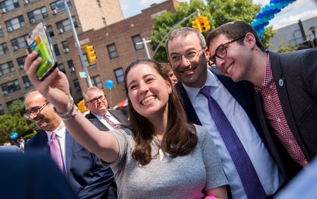 """YU's new president, at the """"InvestFest"""" street fair on Amsterdam Avenue after the investiture ceremony, was a sought-after celebrity who happily posed for a selfie."""
