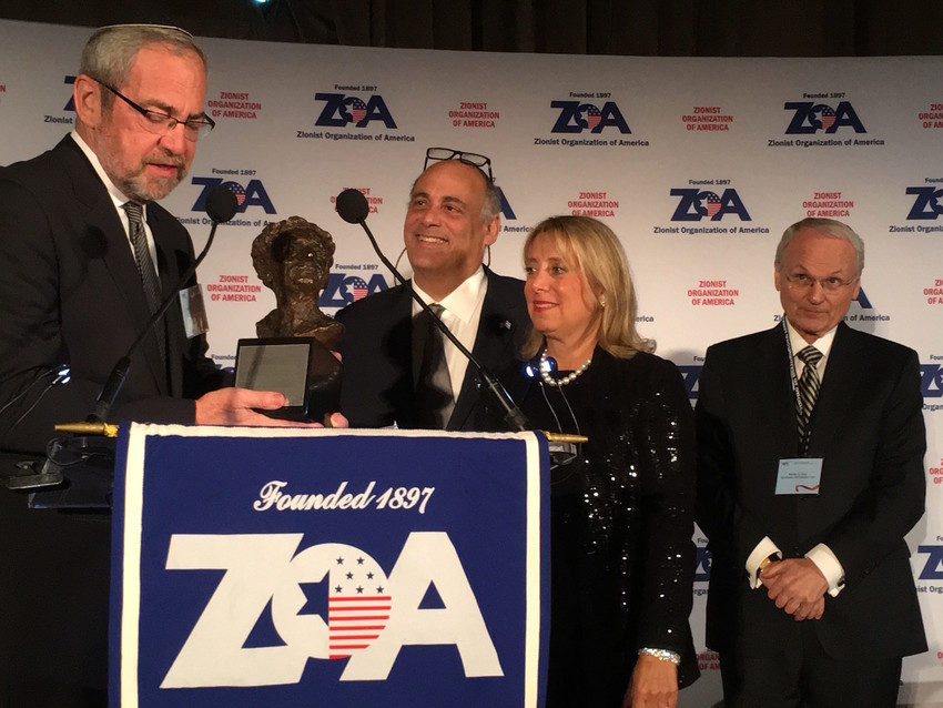 Rabbi Kenneth Hain of Congregation Beth Sholom in Lawrence presents the Louis D. Brandeis award to Shalom and Iris Maidenbaum at Sunday night's ZOA gala, as ZOA President Morton Klein looks on.