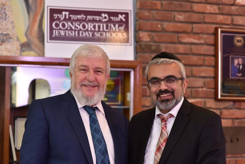 Rabbi Dr. Heshy Glass (left), chairman of the Consortium of Jewish Day Schools, and Rabbi Yaakov Sadigh, principal of HANC's Samuel and Elizabeth Bass Golding Elementary School.