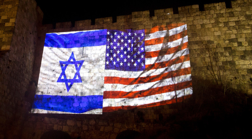 US and Israeli national flags projected on the wall of Jerusalem's Old City on December 6, 2017 in Jerusalem, Israel.