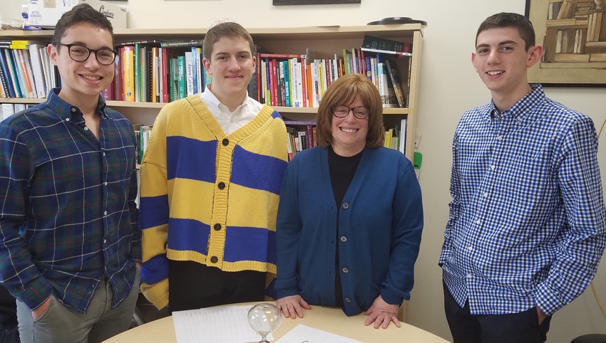 Robin Schick, who oversaw each student's application, is pictured with Jake Weinstock, Jacob Appel and Sruli Fruchter.