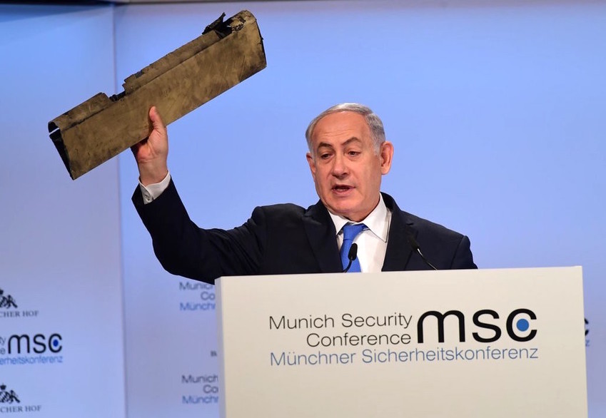 At the Munich Security Conference, Prime Minister Netanyahu displays a fragment of an Iranian drone destroyed over Israeli airspace last week.