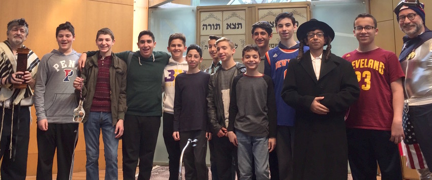 For 16 years, Dr. Paul Brody (at left) of Great Neck has instructed North Shore Hebrew Academy students in the sacred ritual of chanting the Megillah.