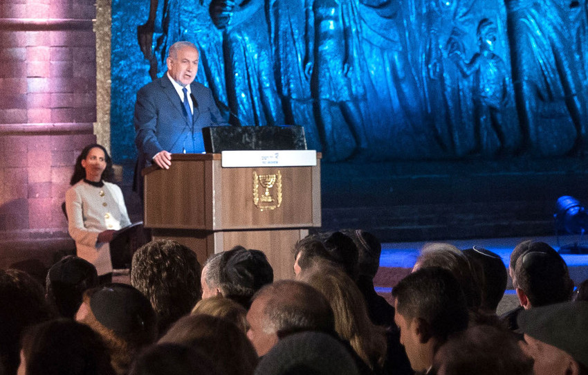 Israeli Prime Minister Benjamin Netanyahu speaks at the official state ceremony held at the Yad Vashem Holocaust Memorial Museum in Jerusalem, as Israel marked annual Holocaust Remembrance Day on April 11.