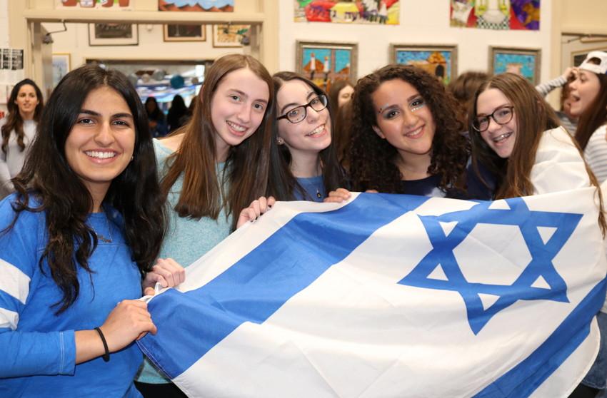 Israel pride at SKA: From left — sophomores Avigail Razi, Emily Haller, Ahava Rosenberg, Tehila Bitton and Shana Motovich.