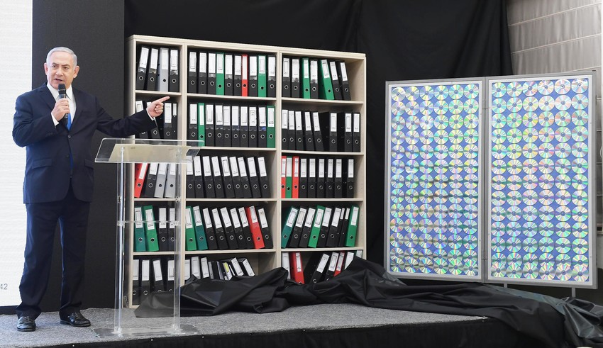 During his televised address on Monday, Israeli Prime Minister Benjamin Netanyahu points to shelves filled with secret files documenting Iran's nuclear weapons program.