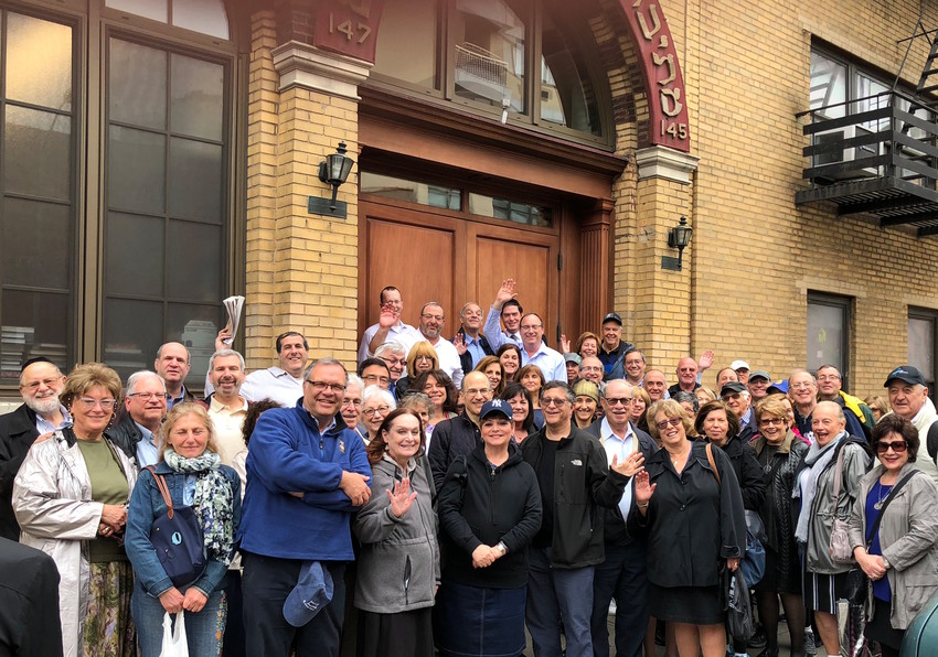 Young Israel of Woodmere members outside the Mesivta Tifereth Jerusalem shul during their walking tour of the Lower East Side.