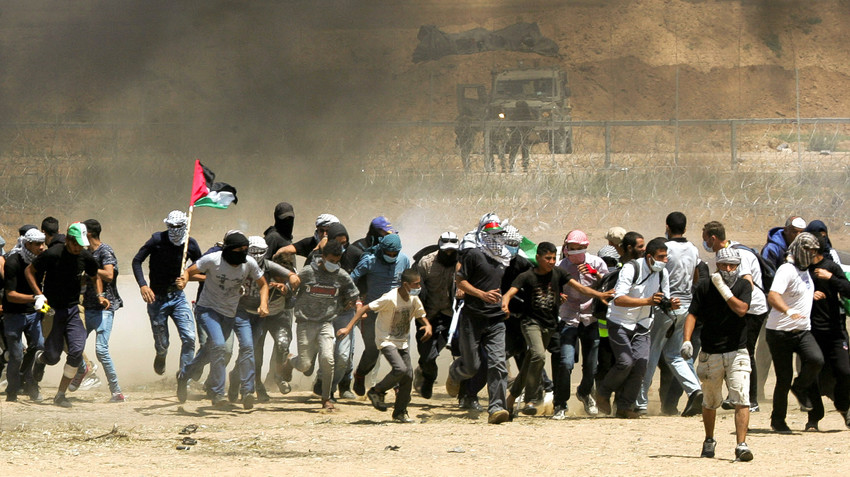 Palestinian protesters during clashes with Israeli forces along the border with the Gaza strip east of Gaza City on May 11.
