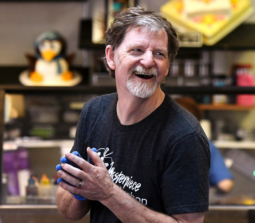 Jack Phillips, owner of the Masterpiece Cakeshop, celebrates in his Colorado store after the U.S. Supreme Court voted 7-2 in his favor in a dispute with a gay couple.