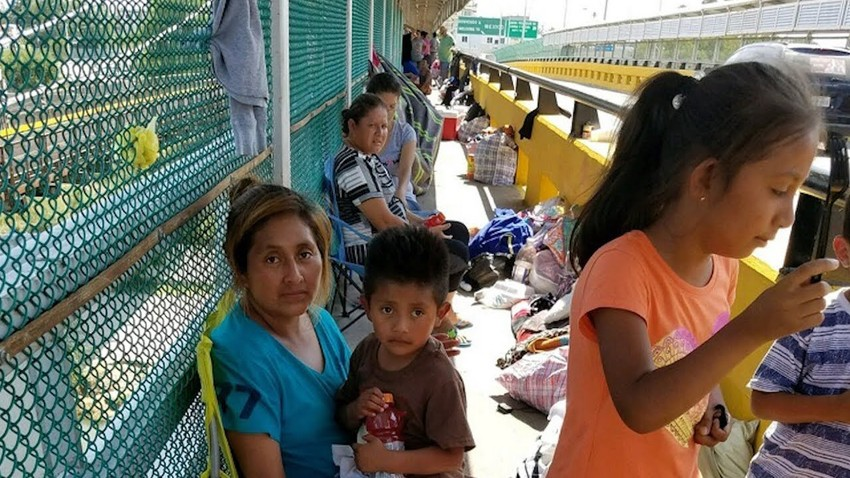Children with their parents at the U.S.-Mexico border.