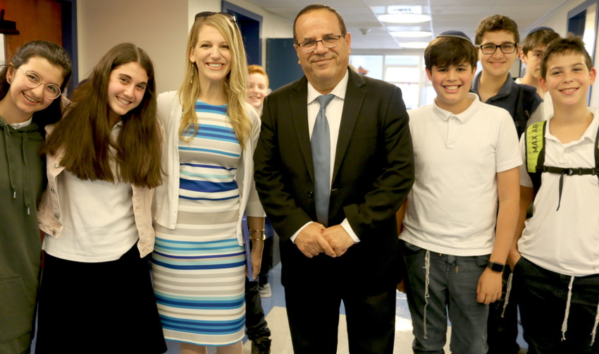 MK Ayoub Kara and Head of School Ms. Raizi Chechik pose with MDS students.