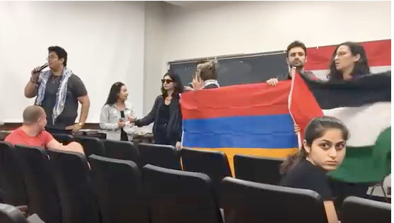 """Anti-Israel disruptors surrounded a small number of students attending a Students Support Israel panel discussion titled """"Indigenous Peoples Unite,"""" on the UCLA campus on May 17."""