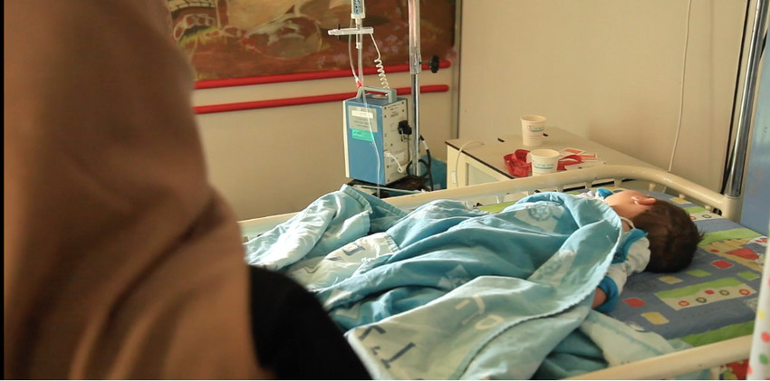 A Syrian mother with her ailing child, who is being cared for at Hadassah's Ein Kerem hospital in Jersualem, in a scene from a video on this unusual undertaking, which can be viewed at bit.ly/2JTyrTV