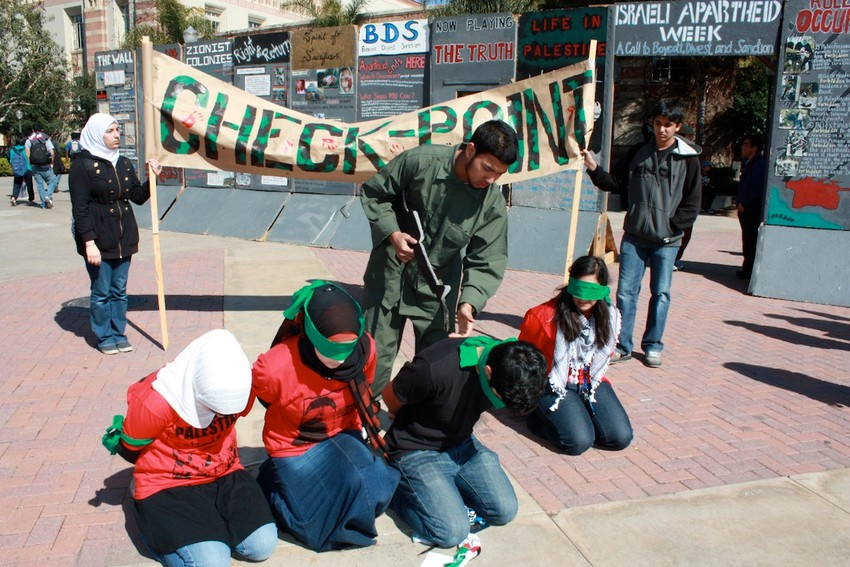 """A mock Israeli checkpoint set up during """"Israeli Apartheid Week"""" on the campus of University of California, Los Angeles."""